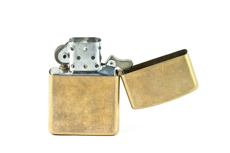 butane: Brass metal lighter isolated on white background  Stock Photo