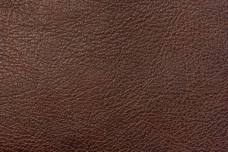 Closeup texture of brown leather use for background  photo