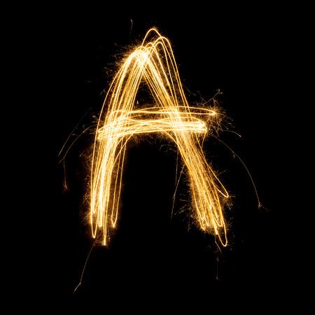 Sparkler firework light alphabet A with uppercase isolated on black background.