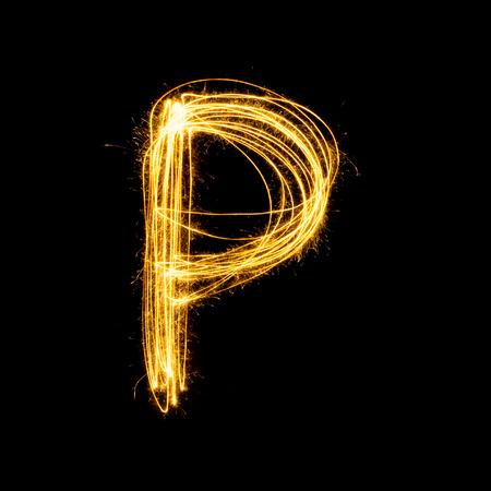 Sparkler firework light alphabet P with uppercase isolated on black background.