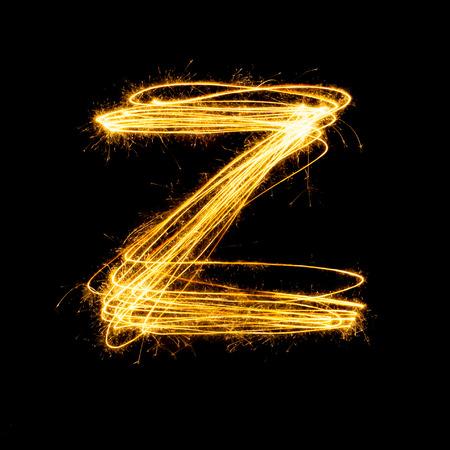 Sparkler firework light alphabet Z with uppercase isolated on black background.