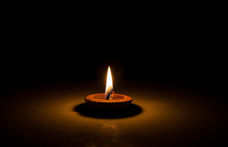 The candle flame in the dark closeup Stock Photo