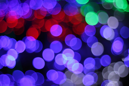 Colorful defocused bokeh lights background. Festive background with natural bokeh. Stock Photo