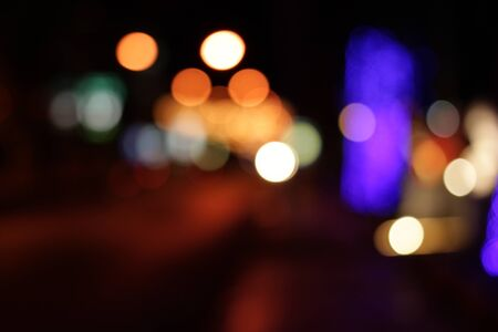 Colorful defocused bokeh lights background. Festive background with natural bokeh. Abstract blur background. photo