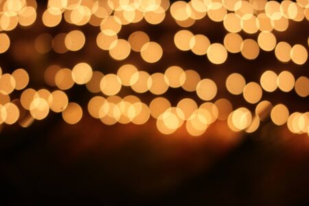 soft background: Colorful defocused circular gold bokeh lights background. Festive background with natural bokeh. Abstract blur background. Stock Photo
