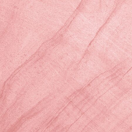 Pink sandstone texture. Closeup stone surface natural abstract background with grain and creative filtered color.