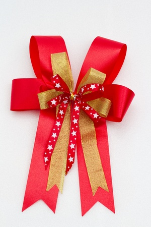 Red satin gift bow. small star and gold ribbon. photo