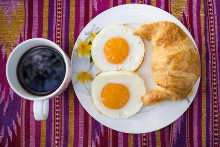 hashbrown: The breakfast on the patterned fabric. Stock Photo
