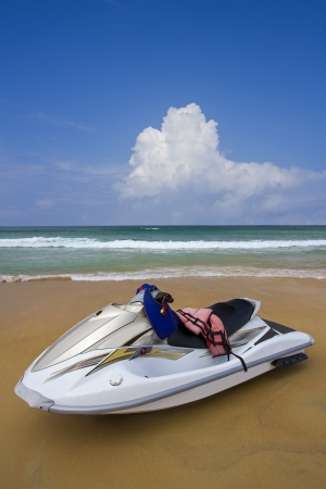 White Jet ski on the beach.