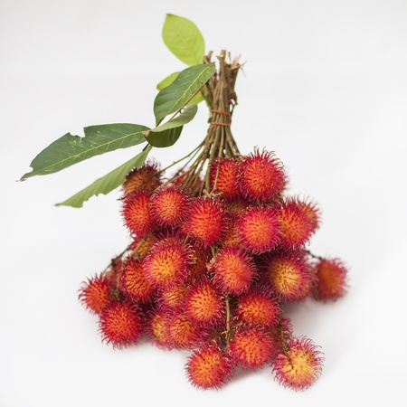 Rambutan Thai with leaves isolated background  Stock Photo