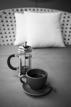 coffee on the seat for relaxation  Black and white photo  photo