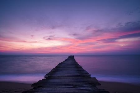 woody bay: pier in amazing sunrise  Stock Photo