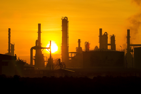 petrochemical: Petrochemical plant in silhuoette and sunset background. Stock Photo