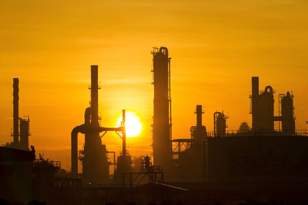 Petrochemical plant in silhouette and sunset