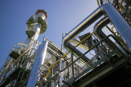 Pipe and tower in petrochemical plant. Stock Photo