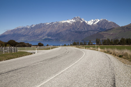 Mountain and farm on scenic road form Queenstown to Glenorchy, New Zealand Stock Photo