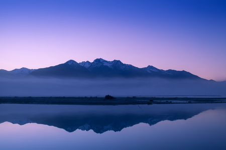 New Zealand mountain peak and snow in morning twilight. Stock Photo