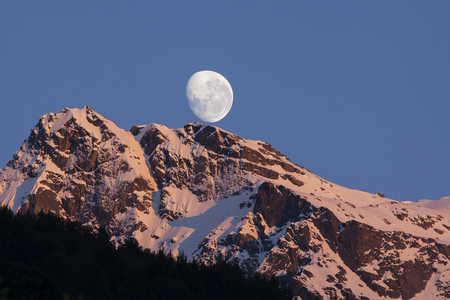 The Moon and snow mountain peak in New Zealand Stock Photo