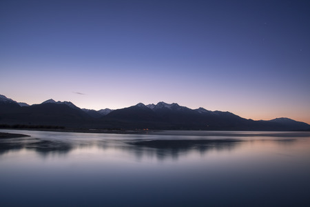 Morning twilight and snow mountain peak at Lake Wakatipu in Glenorchy, New Zealand.