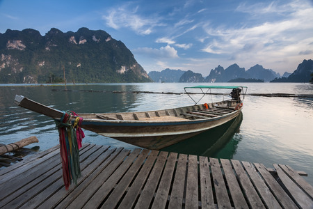 Wooden long-tail boat on a lake in Ratchaprapha dam, Khao Sok National Park, Surat Thani, Thailand Stock Photo