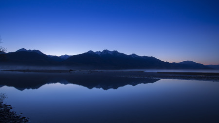 Mountain peak and reflection in morning twilight, Glenorchy, New Zealand.