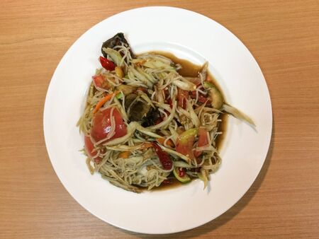 slatternly: Papaya salad with Slatternly or Som Tum Pla la from Thailand. Stock Photo