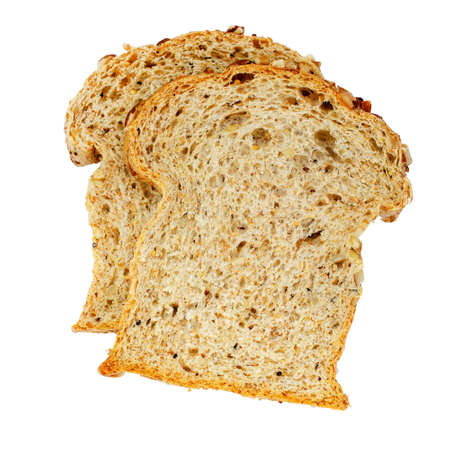 Two pieces of homemade whole wheat bread isolated on white background, ready for breakfast meal