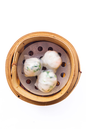 Dimsum in the steam basket   Chinese dimsum steamer prawn isolated on white  photo