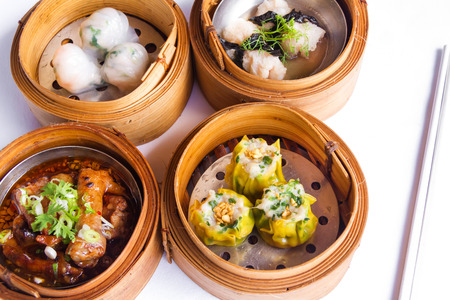 Various Dim Sum in Bamboo Steamed Bowl isolated white