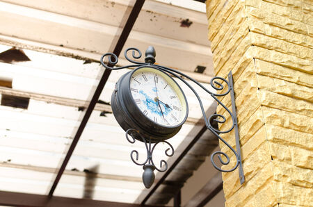old clock on the golden brick wall. photo