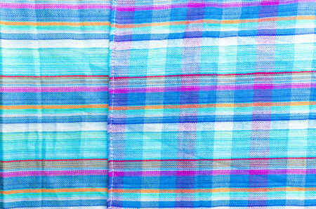 Colorful line patterned fabrics blue green violet yellow texture background photo