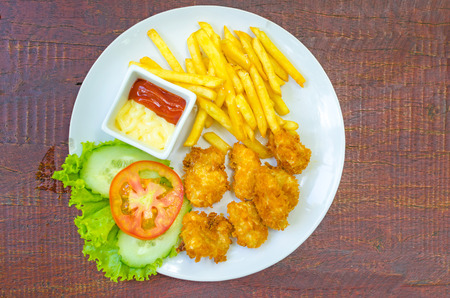 Traditional French potato fries with tomato salad ketchup and mayonnaise . photo