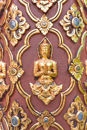 Thai culture sculpture on the temple wall .