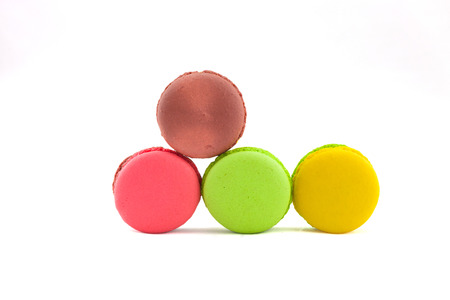 Sweet and colourful french macaroons isolated on white  background . photo
