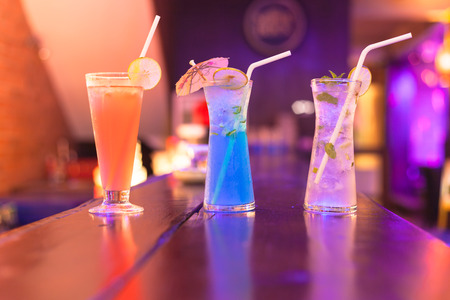 Cocktails on the bar counter in night club .