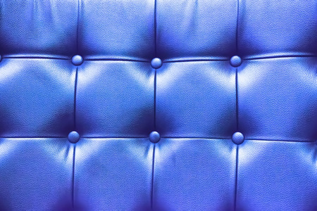 blue leather sofa: Closeup texture of vintage blue leather sofa for background.