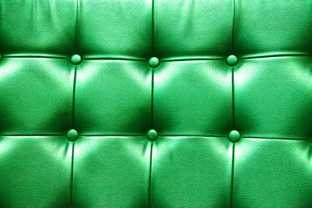 cushioning: Closeup texture of vintage green leather sofa for background. Stock Photo