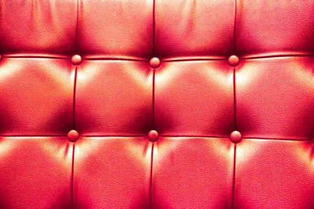 cushioning: Closeup texture of vintage red leather sofa for background. Stock Photo