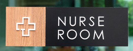 incontinence: Nurse room sign on a Glass wall