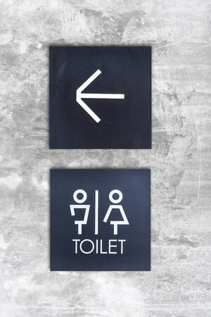 loo: Unisex restroom or Toilet and arrow sign on  concrete wall style boutique . Stock Photo
