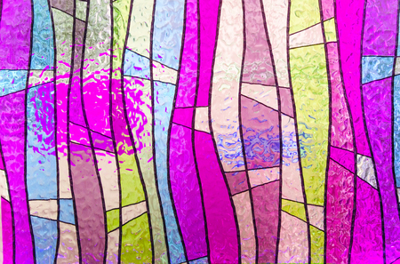 diagonals: Multicolored stained glass church window, portrait orientation Stock Photo