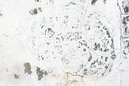unkept: cracked concrete old while wall background.