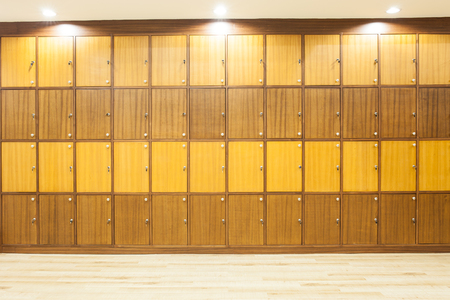 interior lighting: Modern wood Interior of a locker with lighting on top Stock Photo
