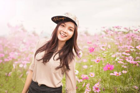 asian natural: Beautiful asian women smiling in pink cosmos flower field .