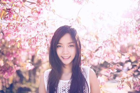 asian gardening: Beautiful asian women with sakura flower in thailand.
