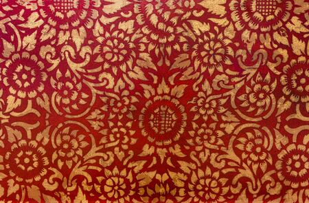 wood textures: The gold leaf on wood for the background and textures. Thai style pattern on red wall .