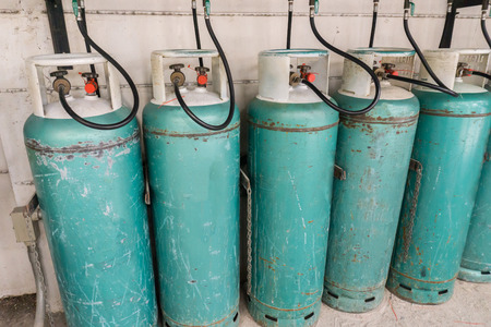 lpg: Keep the gas tank to safety outside the building.  liquefied petroleum gas or LPG. Stock Photo