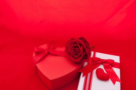 red gift box: Valentines gift box with a red bow on red background. Image of Valentines day.