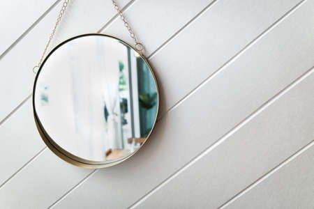 Circle mirror on a white background.