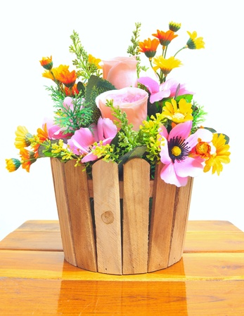 artificial flowers in wooden basket Stock Photo